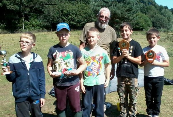 "Secretary Tony Game lines up with the Lads and the trophies presented by Janine Lascelles of the ""Halcyons"" River Waveney Trust Association."